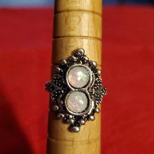 Opalescent stones in silver tone ring setting.
